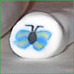 Cernitcane med sommerfugl