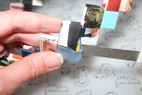 Flette tasker - samle ringen - brug en neglefil til at få flappen ned i lommen